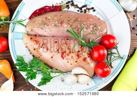 Raw chicken meat with spices - chicken breast with spices on plate