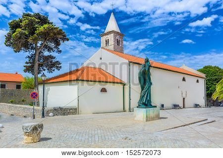 View at colorful square in old town Nin, ancient architecture in Croatia, Europe.