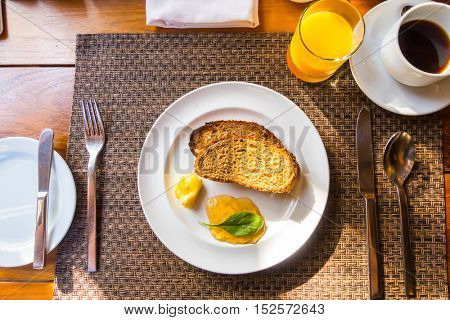 Breakfast with toast and coffee.
