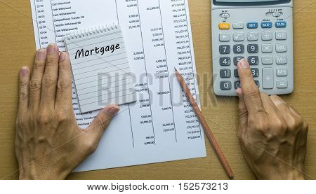 Man Planning monthly Mortgage payment Finance concept