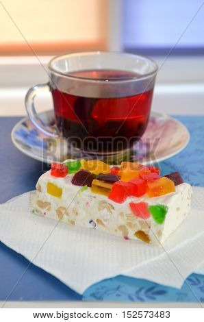 Carcade - Glass cup of red tea and oriental feast with marmalade