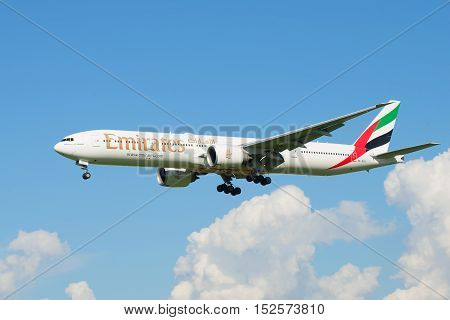 SAINT PETERSBURG, RUSSIA - AUGUST 24, 2016: Flying the Boeing 777-300 (A6-EGU ) Emirates Airline above the clouds