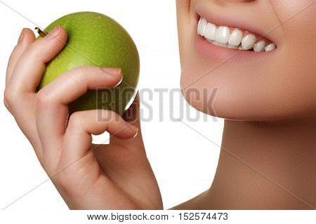 Closeup Of The Face Of A Woman Eating A Green Apple, Isolated Ag