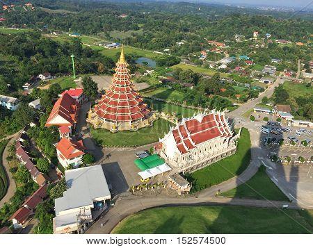 CHIANG RAI THAILAND - OCTOBER 18 : top view of Wat Huay pla kang on October 18 2016 in Chiang rai Thailand. Wat Huay pla kang (thai name) major religious attractions of Chiang Rai Thailand. Drone Shot.