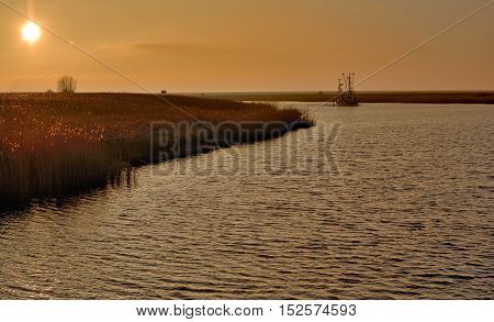 homecoming Crab Fishing Trawler in East Frisia at North Sea in Greetsiel,Lower saxony,Germany