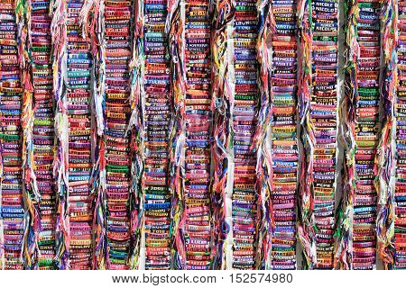Collection of colorful handmade bracelets with personal names