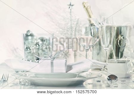 Holiday place setting with glasses and champagne