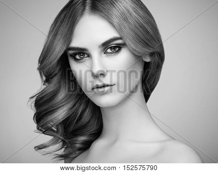 Portrait of beautiful sensual woman with elegant hairstyle. Perfect makeup. Beauty fashion. Eyelashes. Lips. Cosmetic Eyeshadow. Black and White