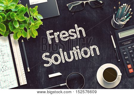 Business Concept - Fresh Solution Handwritten on Black Chalkboard. Top View Composition with Chalkboard and Office Supplies on Office Desk. 3d Rendering. Toned Illustration.