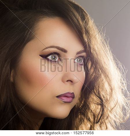 Beauty portrait about woman with purple make up.