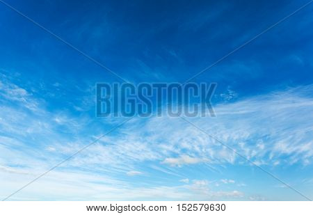 Blue sky with air white clouds. Beautiful heavenly background.