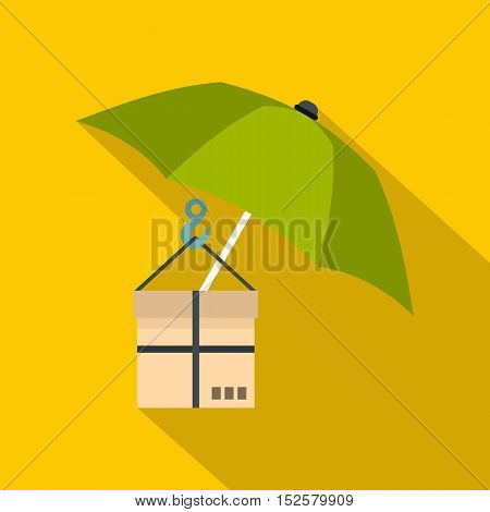 Green umbrella and a cardboard box icon. Flat illustration of umbrella and a cardboard box vector icon for web isolated on yellow background