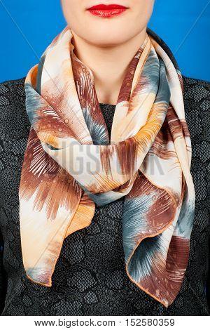 Silk Scarf. Beige Silk Scarf Around Her Neck Isolated On Blue Background.