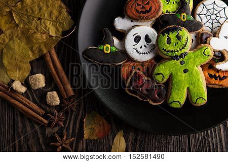 Homemade delicious ginger biscuits for Halloween on wooden table