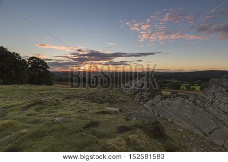 An image of the evening sun sinking over Leicestershire shot from Bradgate Park, Leicestershire, England, UK.