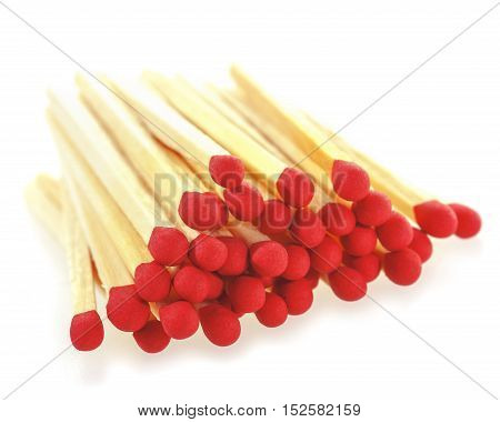 Stack of matchsticks on a white background. Soft focus view.