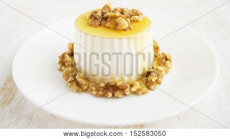 Burgos cheese with honey and walnuts on white plate. Traditional Spanish dessert selective focus horizontal