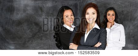 Group of business women working together in dress clothes