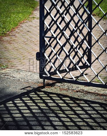 abstract retro background forged iron gate open with shadow
