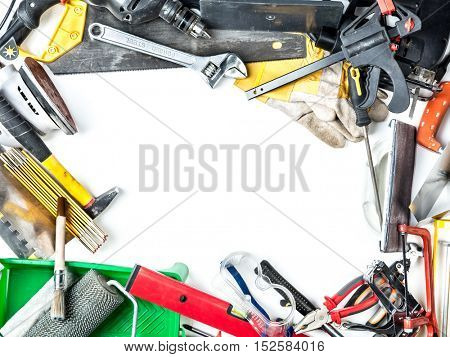 Framework made of various hand tools and accessories with white copy space