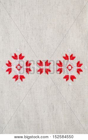 Element Handmade Embroidery On Flax By Red And White Cotton Threads. Background With Embroidery.