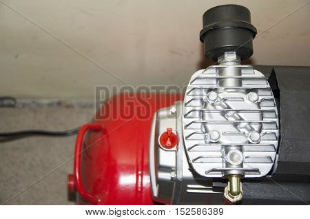 Part of air compressor on a whall background