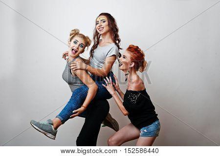 Fashion Studio Portrait Of Three Funny Girls With Bright Make Up
