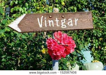 A pointer to Vintgar gorge on a wooden Board, Slovenia. Vintgar gorge is a popular tourist destination in Slovenia.