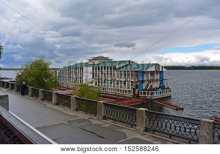 View from enbankment on old dock on the Volga river in Samara city, Russia. Cloudy autumn day