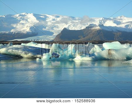 Numerous huge icebergs floating on Jokulsarlon Glacier Lagoon of South Iceland