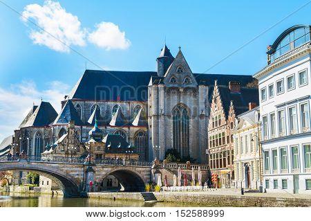 Ghent, Belgium - April 12, 2016: Medieval St. Michael Bridge, church and canal in Ghent, Belgium