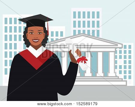 African-American woman in a gown graduate with a diploma on the background of the university building