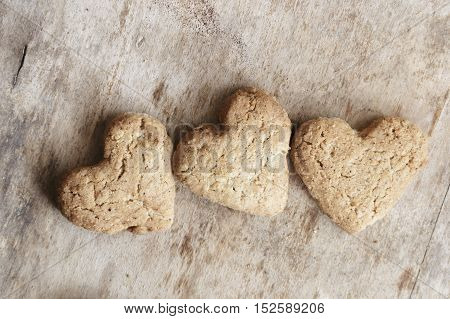 heart cookies on a wooden brown background, valentine's day idea