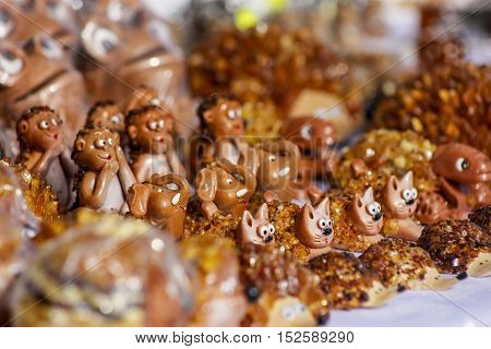 Handmade latvian tresures amber and clay made cats elephants and other animals