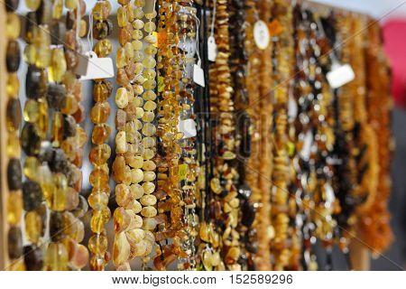 Hanging handmade latvian tresures amber necklaces at the market