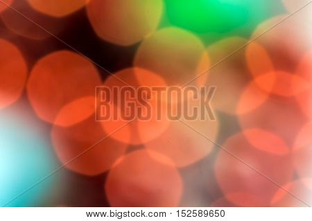 Festive blur - red and green round bokeh. Defocused image. Colorful backdrop for cards, posters, banners.