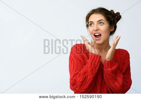 Happy young woman portrait on grey background