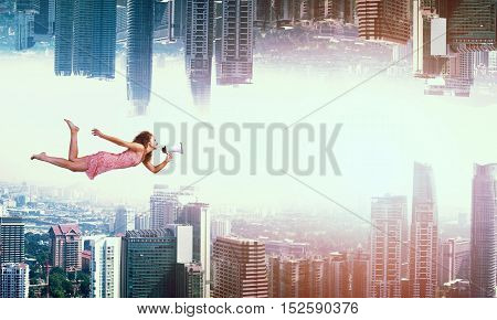 Young woman flying between two reality worlds