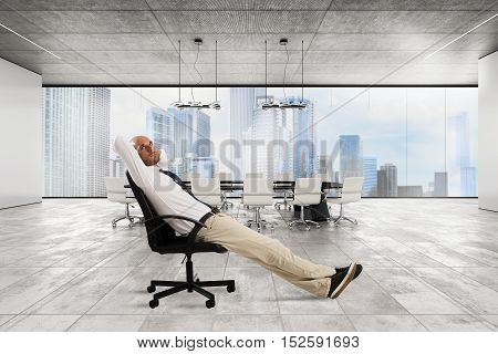 Successful businessman sitting in a chair in his luxury executive office
