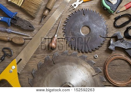Various vintage tools on a wooden background