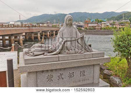 UJI JAPAN - JULY 27 2016: Monument to Murasaki Shikibu (973-1031) near Uji River in Uji Japan. Shikibu is an author of famous Tale of Genji (Genji Monogatari circa 11th c.)