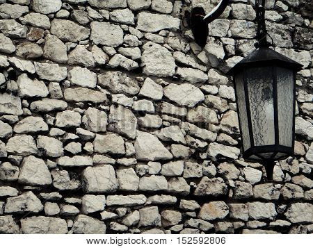 Old stone wall with lantern for Background concept