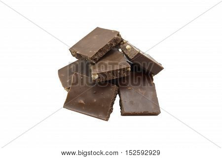 Broken chocolate stack with hazelnuts. Isolated on a white background.