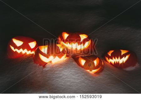 Halloween Pumpkins On Wood In A Spooky Forest At Night