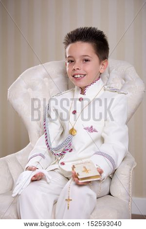 Young Boy With Prayer Book And Rosary In His First Holy Communion
