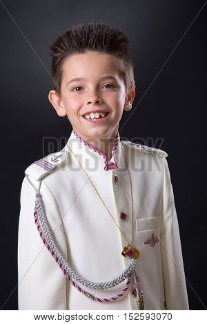 Young Boy Smiling In His First Holy Communion