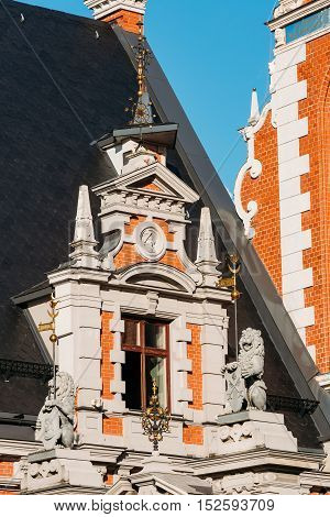 Riga, Latvia. Close View Of The Window, Decorated With Sculptures Of Lions At The Facade Of The Schwabe House, Located At Town Hall Square.