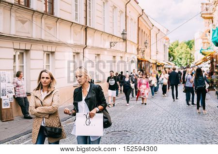 Vilnius, Lithuania - July 09, 2016: Two Women Walking On The Crowded Pedestrian Paved Street And Talking To Each Other In Summer Day.
