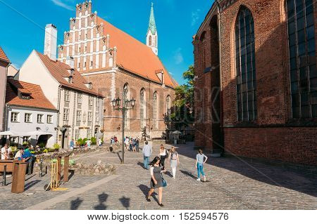 Riga, Latvia - June 30, 2016: View Of St. John's Lutheran Church, The Monument Of Medieval Church Gothic Architecture With Corbie-Steps In Sunny Day.