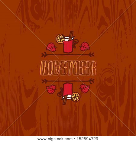 Hand-sketched typographic element with mulled wine, leaves and text on wooden background. November